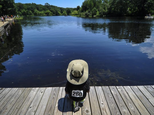 Oliver Raghavendra waits patiently for a fish to bite at the Freshwater Fishing Derby at Turkey Swamp Park in Freehold Township on June19, 2016.