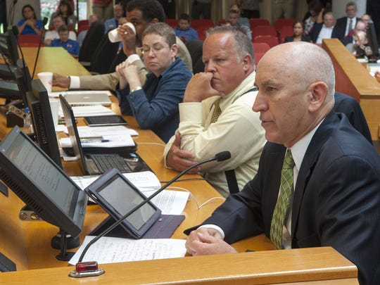 Richard Briggs, right, asks a question during the discussion on selecting a new Knox County Trustee at the commission. Briggs, a Tennessee state senator and physician, voted yes for Insure Tennessee.