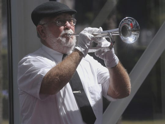 Scott Mills, a Navy veteran who helped evacuate Saigon in 1975, now volunteers to play TAPS at some Pensacola memorial services.