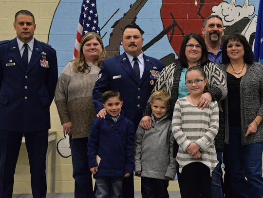 Staff Sgt. Dickison poses with his family after the