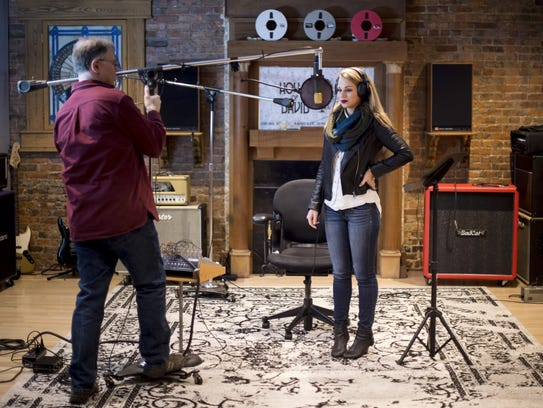 Caitlin Koch, right, prepares for a session with recording
