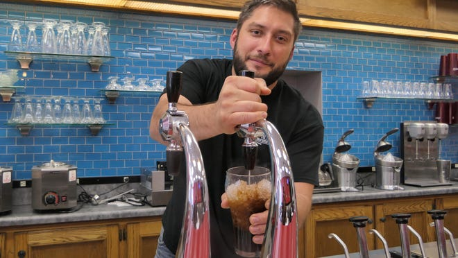 Chef Philip Kuhn is experimenting with freshly mixed root beer at his soon-to-open restaurant, Blue Smoke Barbecue, in Hays.