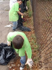 Volunteers pick up trash on North Valley during the