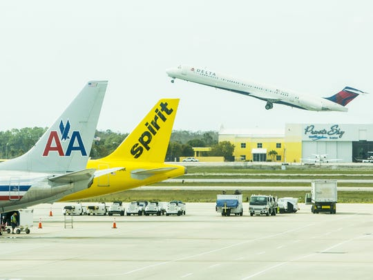 This file photo shows some of the airlines serving Southwest Florida International Airport. American Airlines has announced it will launch seasonal, twice-daily service between Fort Myers and Miami on Dec. 19.