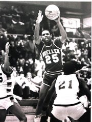 Moeller High School senior Byron Larkin splits the defense in 1984.