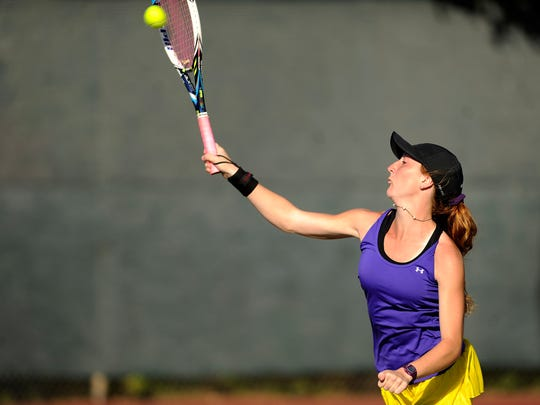 Wylie's Emly Corn serves the ball in her doubles match with partner Ashley Smyser in the Bulldogs' team tennis win over Andrews in the Region I-4A championship match  on Friday, Oct. 28, 2016, at the Rose Park Tennis Center.