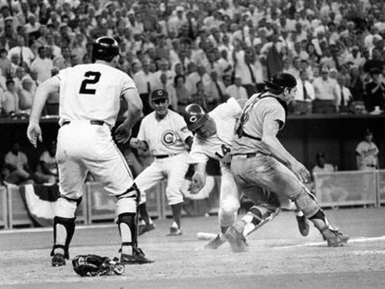 Pete Rose slams into Cleveland Indians catcher Ray
