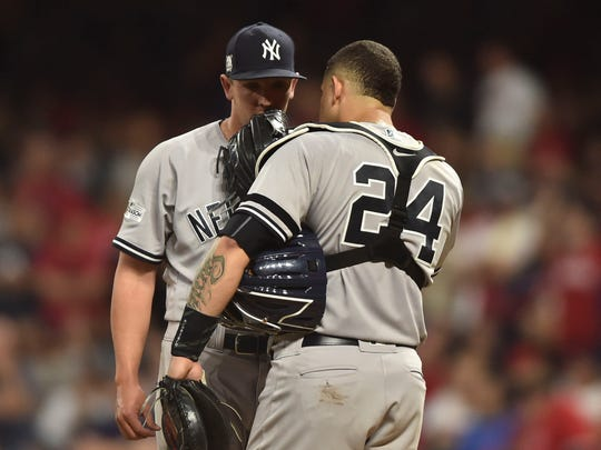New York Yankees relief pitcher Chad Green (left) talks to catcher Gary Sanchez (24) during the sixth inning in game two of the 2017 ALDS against the Cleveland Indians at Progressive Field on Friday, Oct. 6, 2017.