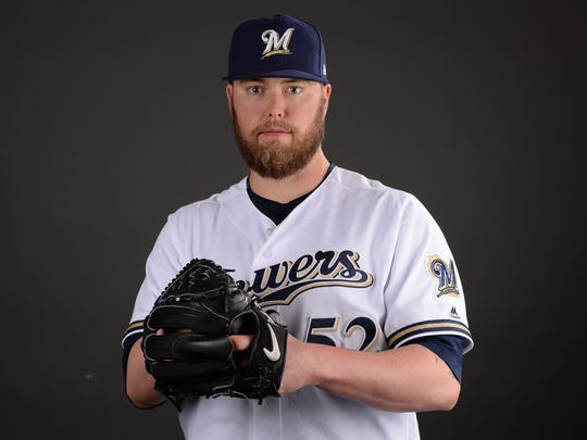 Brewers pitcher Jimmy Nelson poses for a photo during