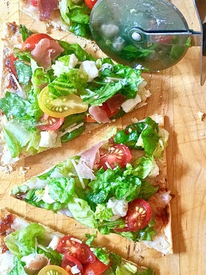 Quick and Healthy Italian Salad Pizza is made with flat bread.