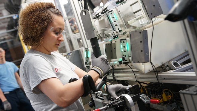 DENSO employee Shaenna McCormick works at the auto-parts company's Battle Creek, Mich., plant. DENSO is recruiting for engineering, skilled trades and co-op/internships at the North American International Auto Show.