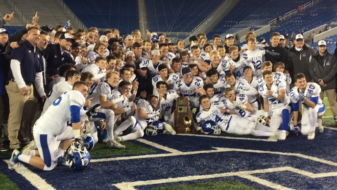 The Covington Catholic High School football team celebrates a 5A state title in their 50th season, a perfect 15-0.