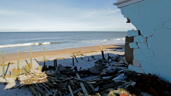 The remains of a seawall stand beyond a destroyed beach home at Ponte Vedra Beach, Fla., Saturday, Oct. 8, 2016, after Hurricane Matthew passed through Friday.