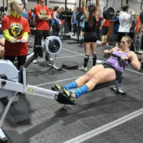 Airmen work out using Concept2 rowers at Davis-Monthan Air Force Base, Ariz. The rower can help you build muscle, improve cardio and increase stamina.