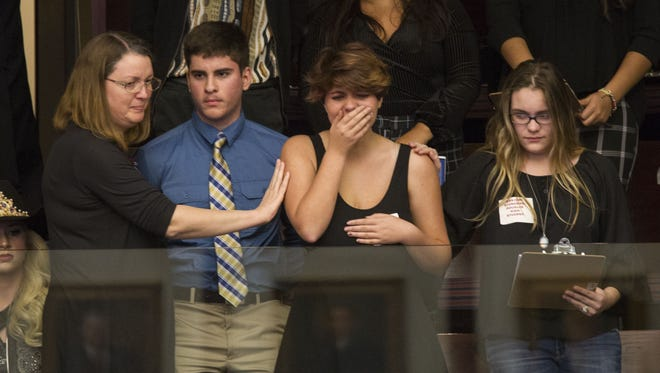 Sheryl Acquarola, a 16-year-old junior from Marjory Stoneman Douglas High School is overcome with emotion in the east gallery of the House of Representatives after the representatives voted not to hear a bill banning assault rifles and large capacity magazines.  Acquarola was one of the survivors of the Marjory Stoneman Douglas High School shooting that left 17 dead, who were in Tallahassee on Feb. 20, 2018 to meet with Florida lawmakers.