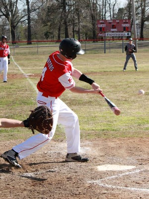 Norfork's Brett Sorters puts the ball in play with Landon Byrd on third base on Monday against Calico Rock.