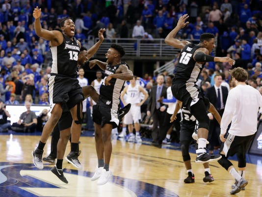 Providence players, including Kalif Young (13) and Emmitt Holt (15), jump after Providence defeated Creighton 68-66 in an NCAA college basketball game  in Omaha, Neb., Wednesday, Feb. 22, 2017. (AP Photo/Nati Harnik)