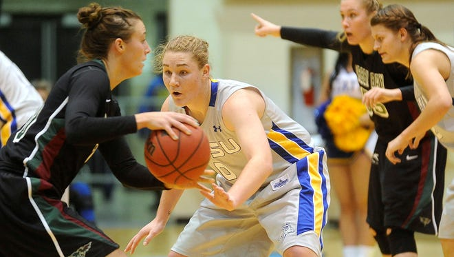 SDSU's #0 Chynna Stevens guards Green Bay's #10 Mehryn Kraker during women's basketball action at Frost Arena in Brookings, S.D., Wednesday, Dec. 10, 2014.