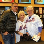 """Ron Darling, the former New York Mets pitcher poses for a photo with Ilene and Myles Seitz from White Plains, as he appears for a book signing for his new book, """"Game 7, 1986: Failure and Triumph in the Biggest Game of My Life."""" at the Barnes & Noble Booksellers in White Plains, April 16, 2016."""