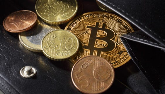 An illustration model of a bitcoin with different Euro coins.