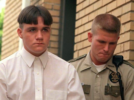 Jason Blake Bryant, 15, left, enters the Greene County