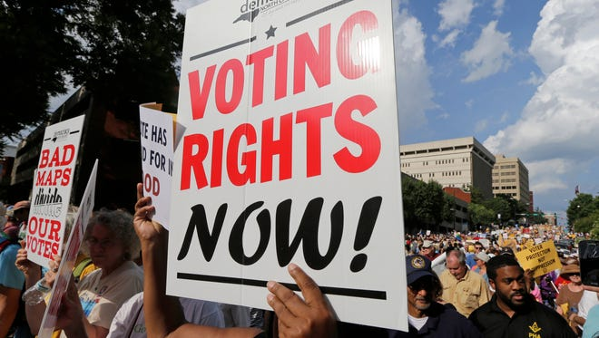 Demonstrators marched through the streets of Winston-Salem, N.C., last July during a federal voting rights trial challenging a 2013 state law.