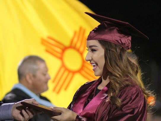 Victoria Salcido received her diploma from board member
