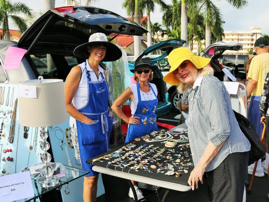 File: Sherry Lourie finds the clip earrings she was searching for at the Treasures In The Trunk sale.