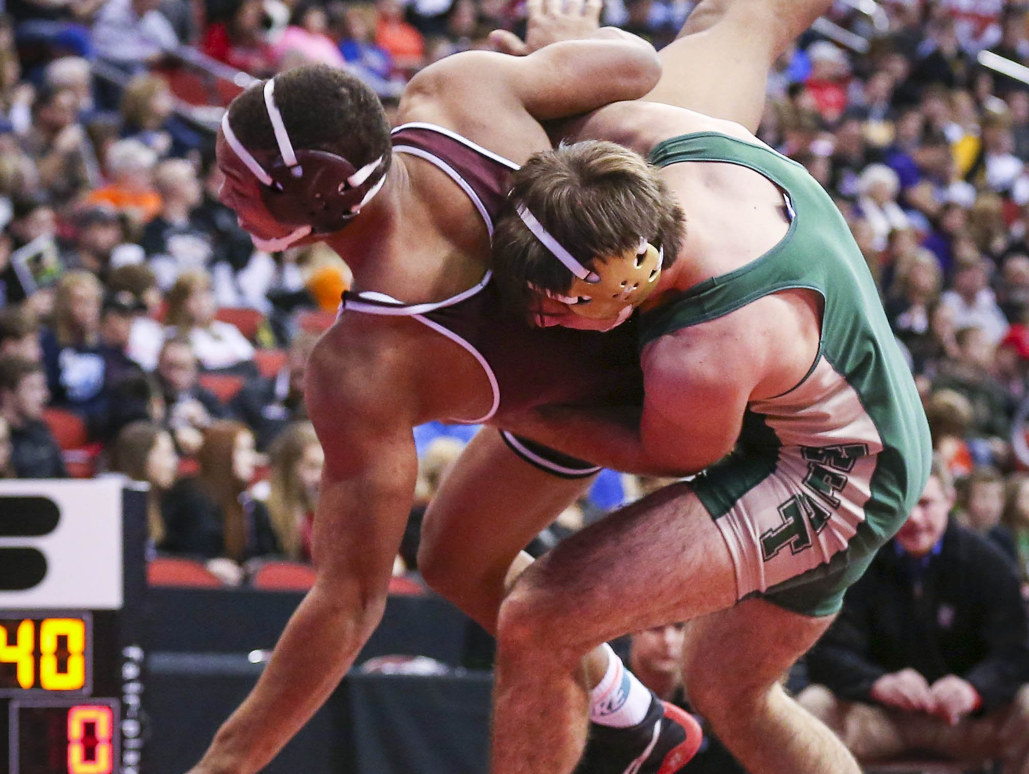 Donovan Doyle (Iowa City West), right, controls Jacob Zachary (Dowling Catholic, WDM) during their 182lbs Class 3A first round match during the 2015 state wrestling championships Thursday Feb. 19, 2015, at Wells Fargo Arena in Des Moines, Iowa.
