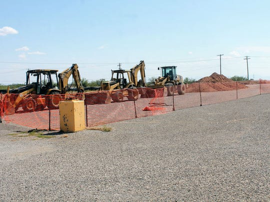 Construction crews set up their equipment at the Hobby Lobby location at White Sands Mall Tuesday, June 27.