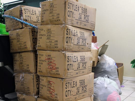 Boxes filled with backpacks are stacked high at Mountain