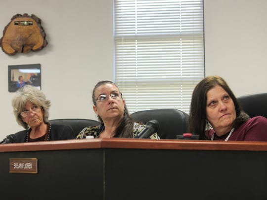 County Commissioners watch a presentation made by Ultra
