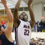 MRA's Devin Gilmore (23) goes up for two against Leake during the MAIS Overall Tournament held at Mississippi College in Clinton.