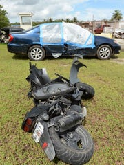 In this Aug. 2013 file photo, the moped and sedan involved