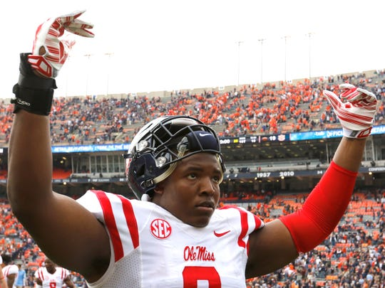 Ole Miss defensive tackle Breeland Speaks celebrates after the team's 27-19 win against Auburn on Saturday, a victory that kept the team in the top 25 polls.