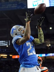 Darius Slay catches an interception in the end zone