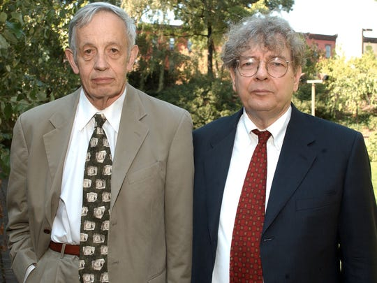 """Dr. John Nash, left, stands with Professor Clancy Douglas Mckenzie, Saturday, Oct. 5, 2002, at Temple University in Philadelphia. Nash and others were honored at a luncheon for winning the O. Spurgeon English Humanitarian award. Nash's life was portrayed in the film """"A Beautiful Mind""""."""
