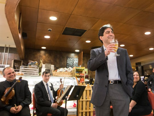 David Amado, music director of the Delaware Symphony Orchestra, gives a toast before the start of the dinner.