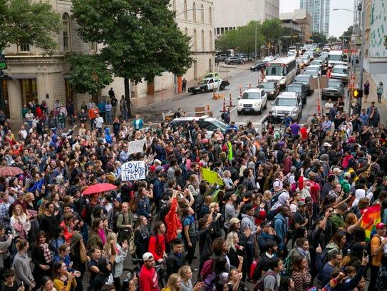 Anti-Trump protesters march along Congress Avenue in