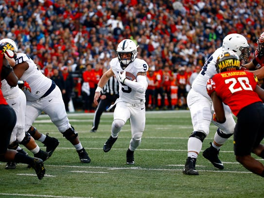 Penn State quarterback Trace McSorley (9) rushes for
