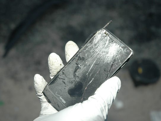 A damaged cell phone retrieved from a crash in Seaford.