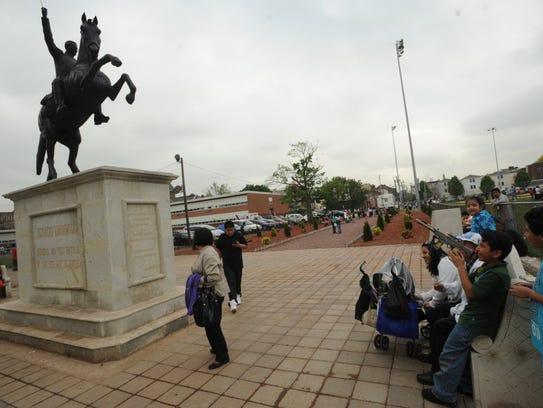 Visitors hang around the statue of Mexican hero Ignacio