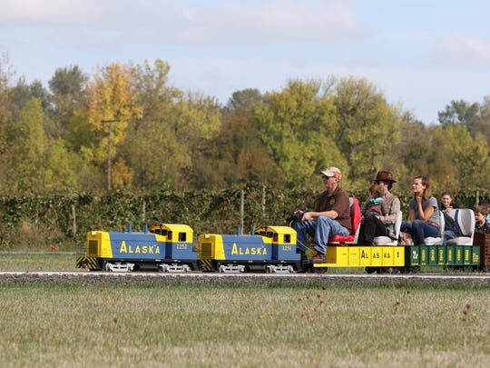 Festival-goers ride the train on Sunday, Oct. 11, 2015, at Heiser Farms in Dayton.