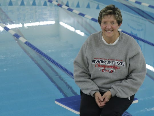 Oshkosh West swimming coach Carrie Bores retired this