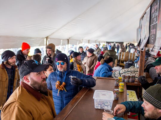 Festival goers stand in line for Odd Side Ales, one