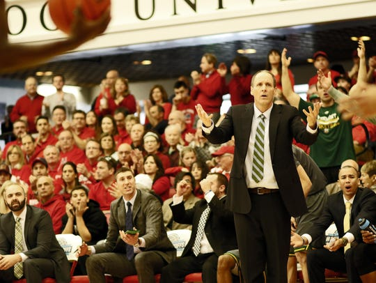 Vermont coach John Becker reacts to an official's call