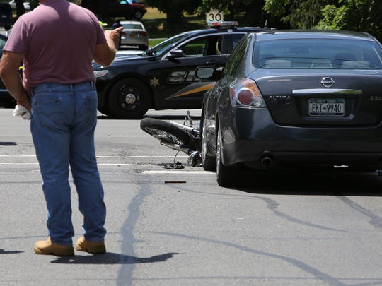 A man driving a motorcycle and his passenger were killed