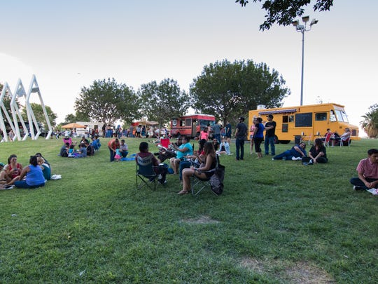 People relaxing and enjoying the evening at the  Food Truck Fiesta on July 20, 2016 at Young Park.