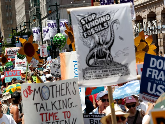 Protesters march during a demonstration in downtown on Sunday, July 24, 2016, in Philadelphia. The Democratic National Convention starts Monday.