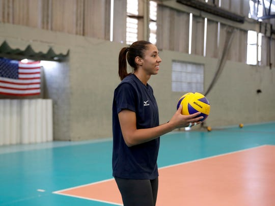 United States' Alisha Glass holds a ball during a women's volleyball practice session at the Navy School High Performance Training Center before the start of the 2016 Summer Olympics in Rio de Janeiro, Brazil last week. (AP Photo/Jeff Roberson)
